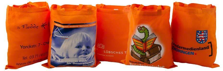 Beispiele für Baumwolltaschen orange 2 kurze Henkel, mit unterschiedlichen Motiven bedruckt