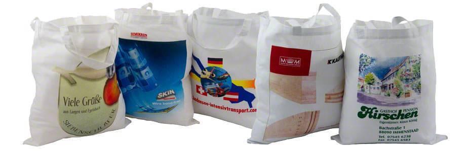 Beispiele für weisse Baumwolltaschen 2 kurze Henkel, mit unterschiedlichen Motiven bedruckt